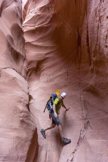 Full length of rock climber walking on mountain