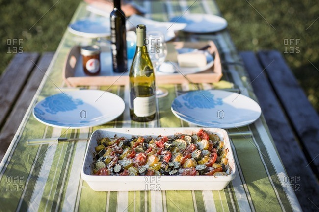High angle view of salad and wine bottles on picnic table