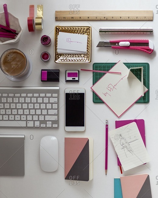 Overhead view of office supplies on desk