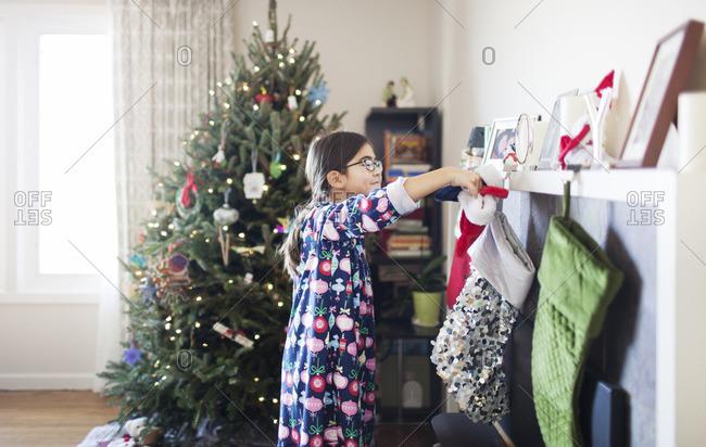Smiling girl with Christmas socks at home