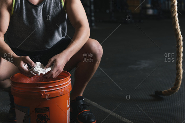 Low section of man with sport chalk in gym