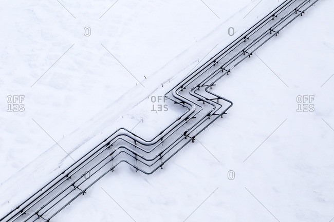 High angle view of pipeline on snow covered field