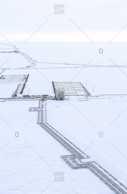 High angle view of pipeline on snowy landscape