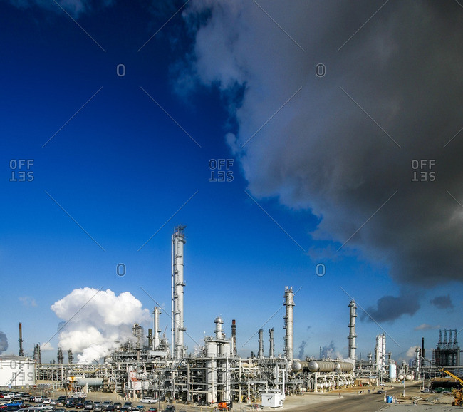 Petrochemical plant against blue sky on sunny day
