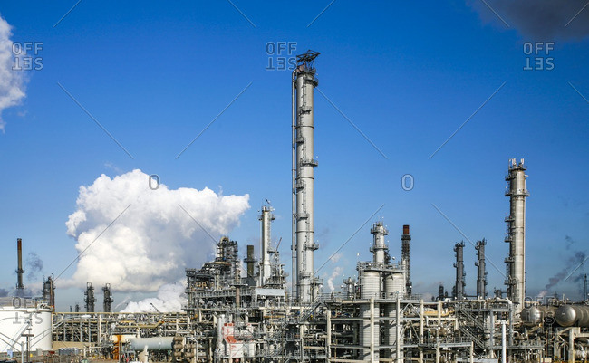 Petrochemical plant against sky on sunny day