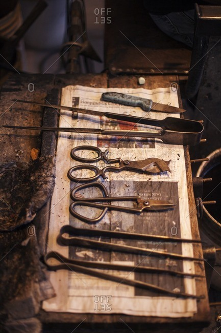 High angle view of hand tools on dirty table at industry