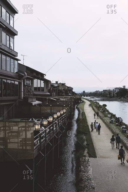 High angle view of people walking on footpath by buildings in city