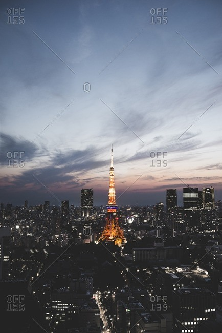 Illuminated Tokyo tower against sky at dusk