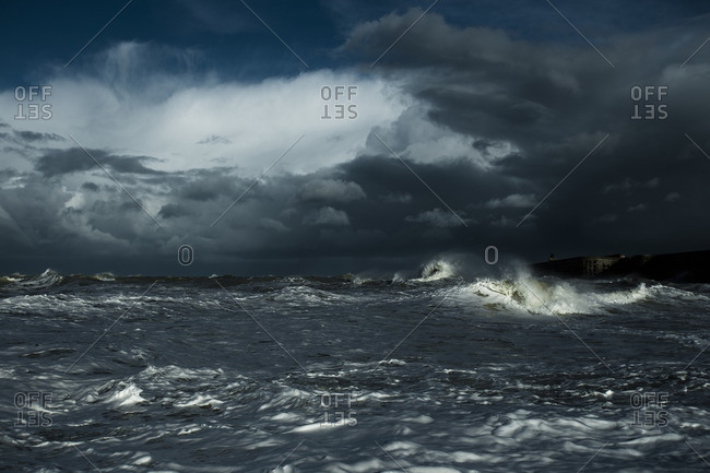 Seascape against sky during thunderstorm at night