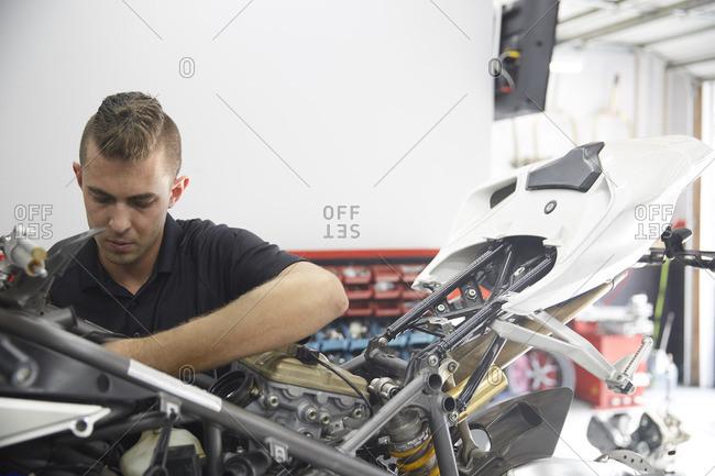 Worker making motorcycle in industry