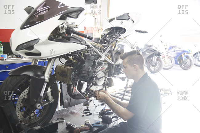 Worker making motorcycle in factory