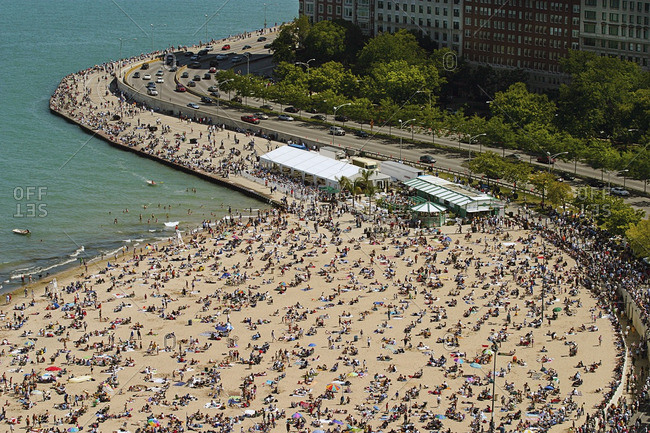 High angle view of people enjoying at beach on sunny day