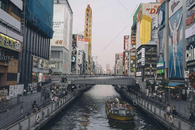 May 14, 2016: The Dotonbori canal, tourists and shopping in, Osaka, Japan