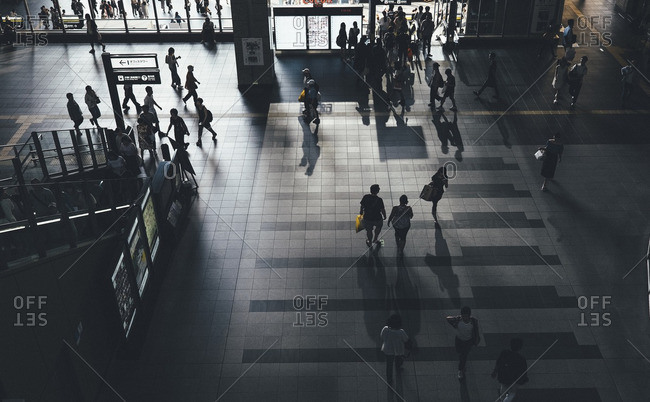 High angle view of people walking at subway station