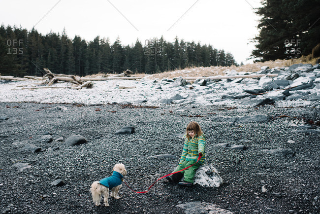 Girl in wilderness with dog