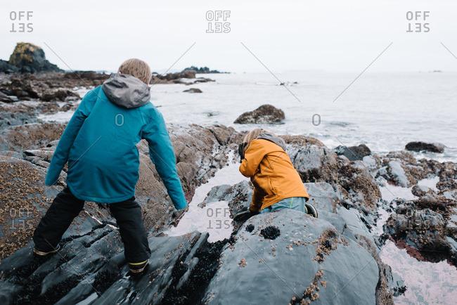 Boys exploring a winter beach