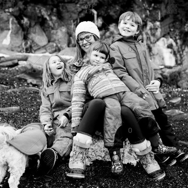 Family on rocky winter shore