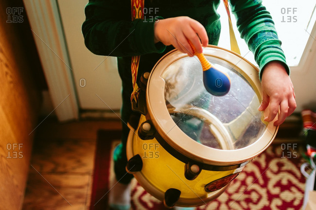 Child with a toy drum
