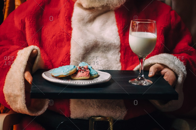 Santa Clause holding tray of cookies