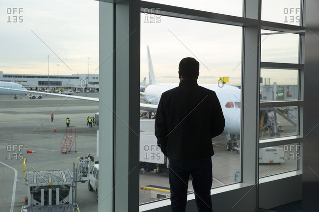 Vancouver, Canada - January 13, 2017: Man silhouetted at airport window