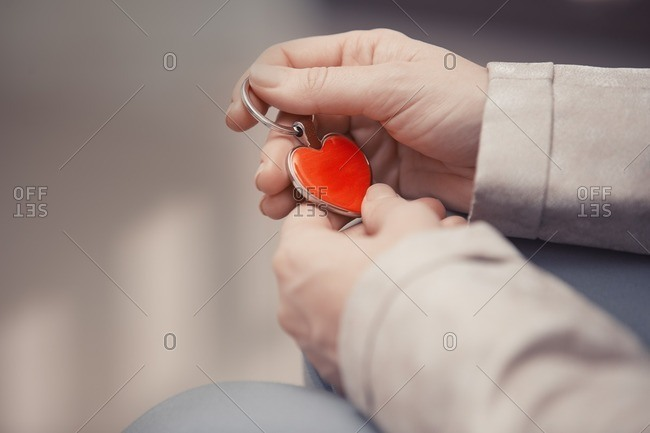 Woman holding heart shaped key ring
