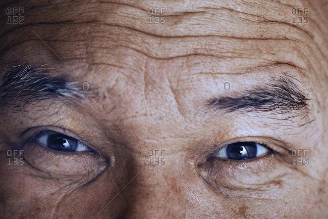 Face of elderly man looking at camera