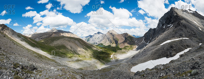 Mountaintop view of valley, lake, mountains in summer