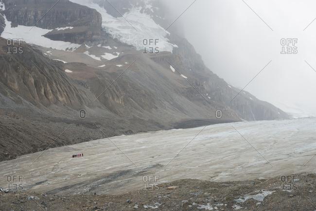 Glacier under foggy sky
