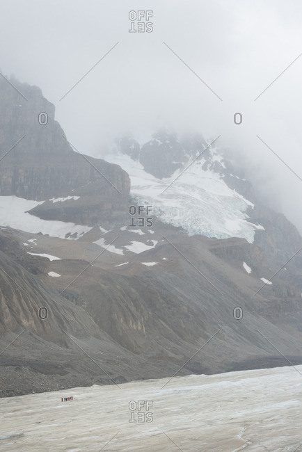 Glacier under foggy sky