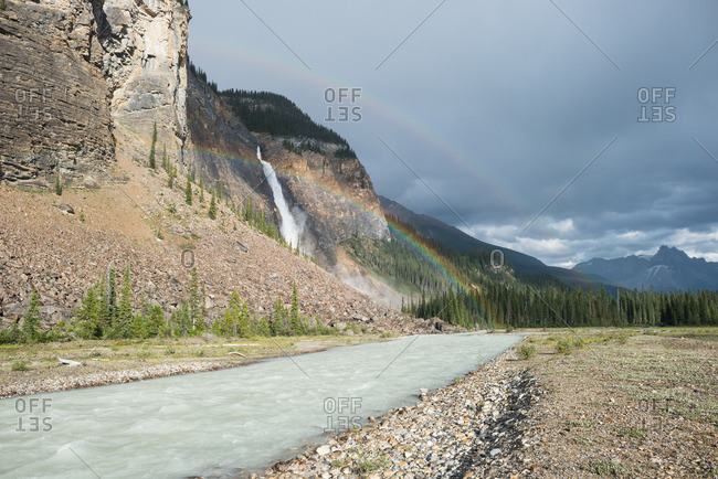 Rainbow beams over Takakkaw Falls in Yoho National Park on a summer day