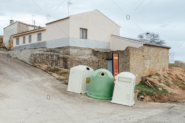 Trash containers in the corner of an old village street, Teruel, Spain