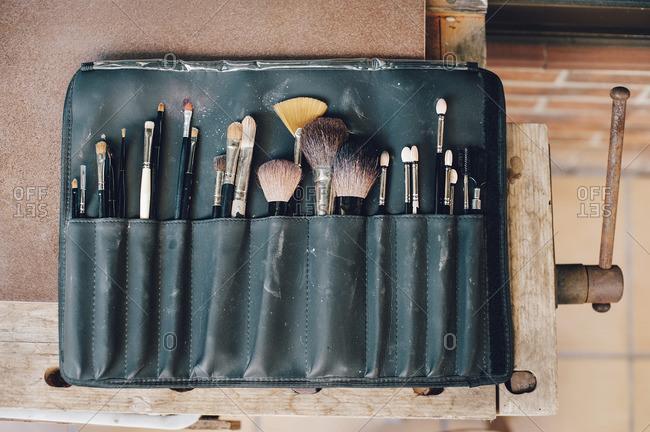 Make up bag full of beauty brushes