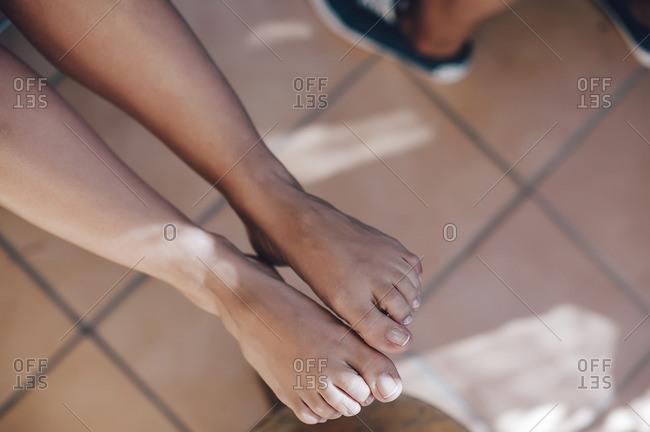 Woman showing fingernail polish on her feet