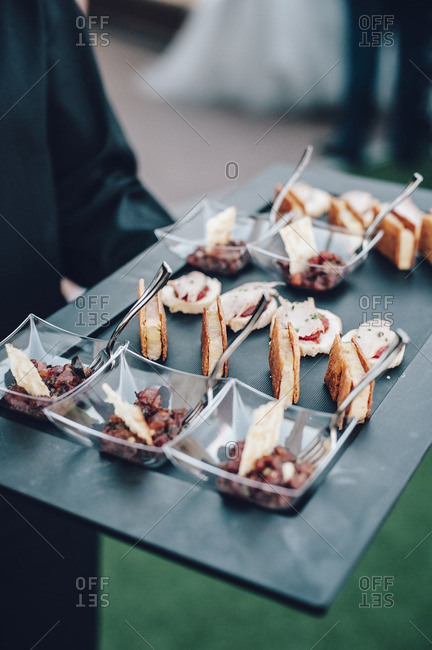 Appetizers being served at wedding