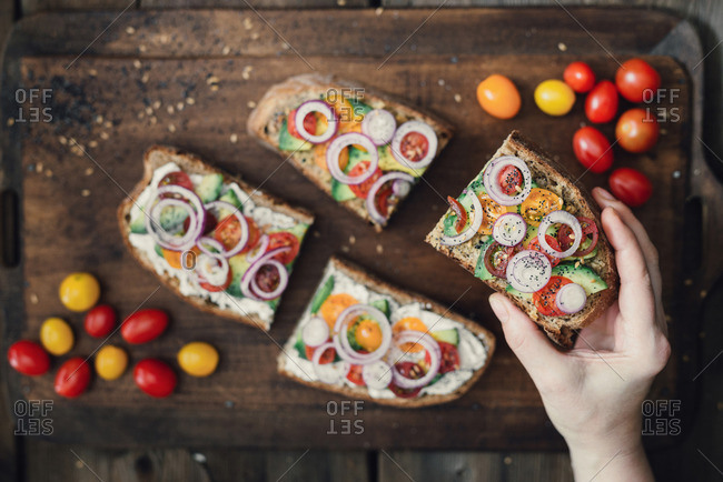Ricotta and olive paste vegetarian sandwiches with avocado and cherry tomatoes