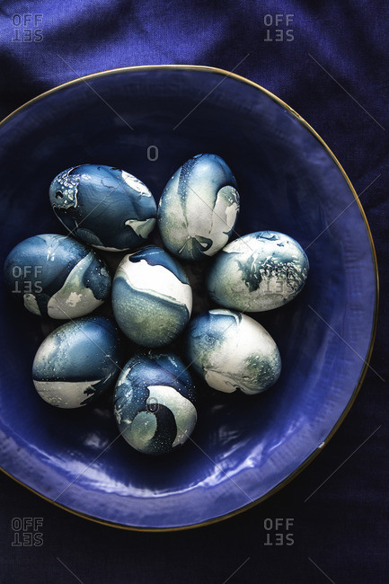Blue shade nail polish marbled Easter eggs