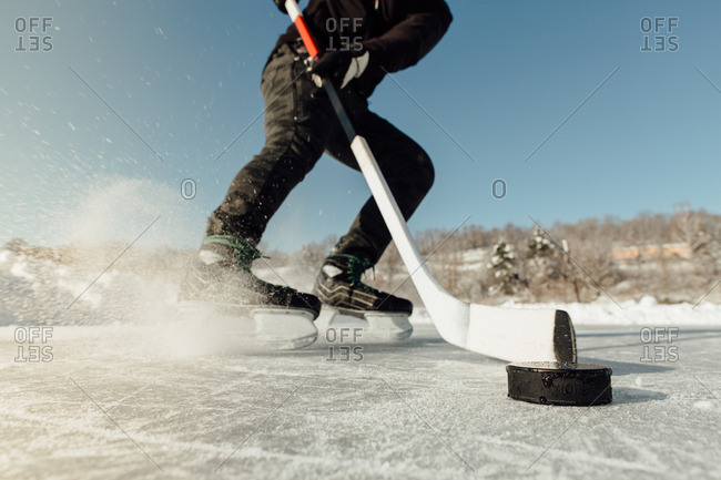 Cropped image of a man puck tracking stopping and spraying ice