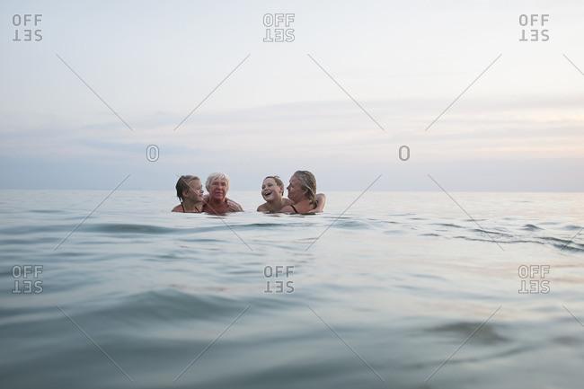 Family swimming in sea