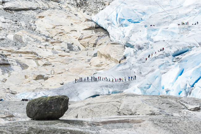 Groups of hikers on glacier