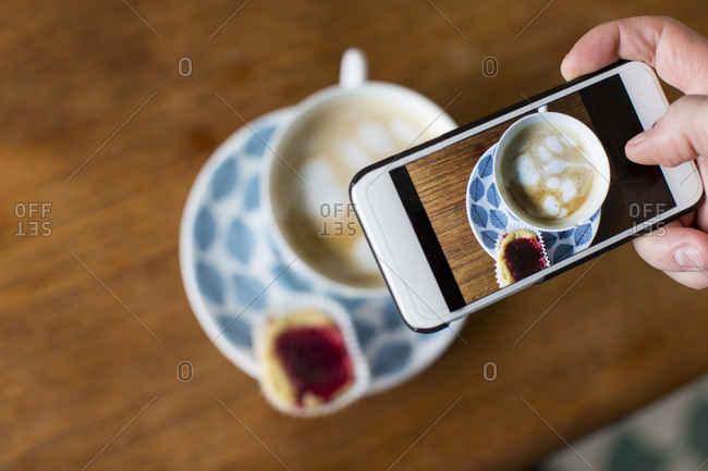 Taking picture of coffee with smartphone