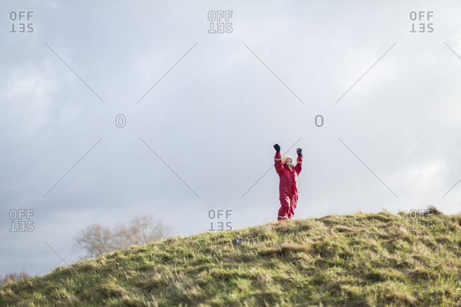 Girl on top of hill