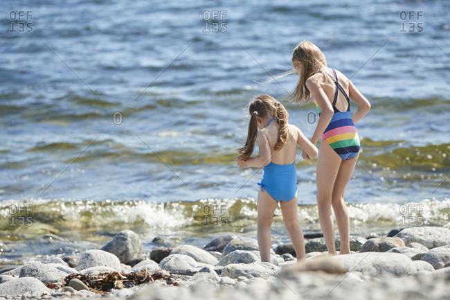 Girls on rocky beach