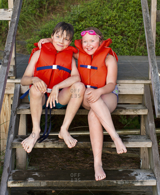Brother and sister wearing life jackets