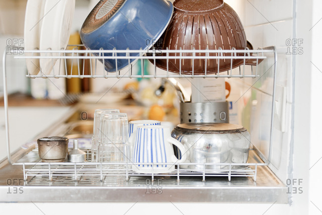 Pots and pans on dish rack