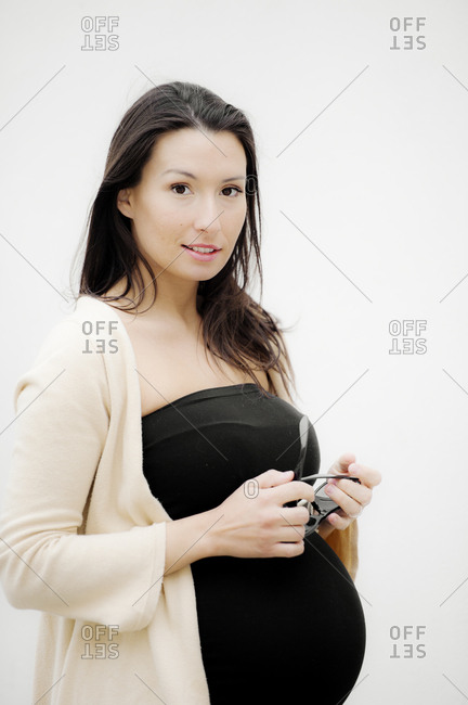 Portrait of pregnant woman on white background