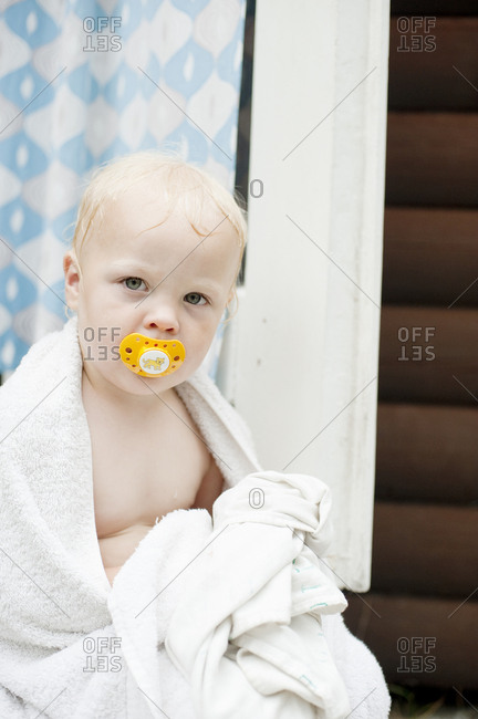 Boy after bath wrapped in towel