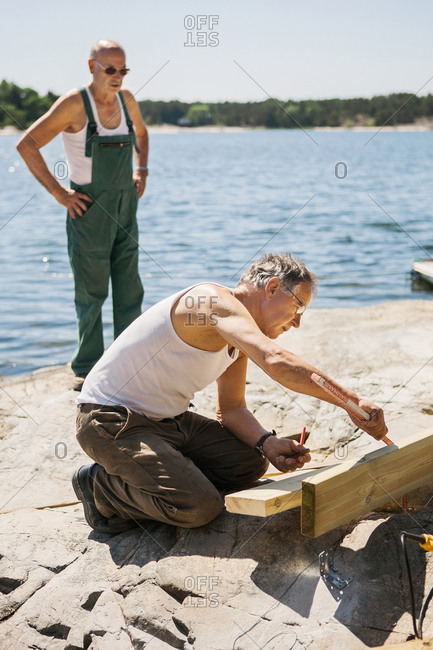 Men doing carpentry at water
