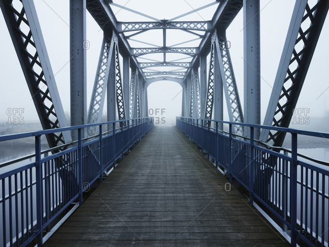 Pedestrian bridge in fog