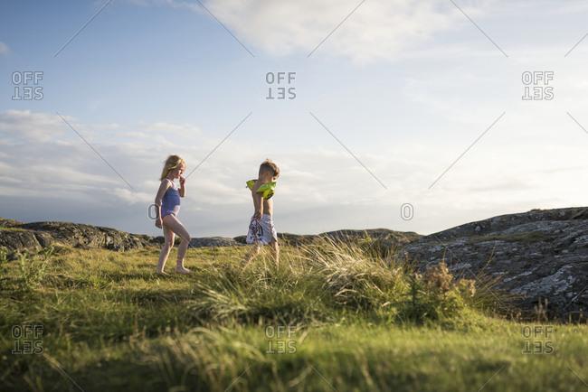 Children on rocky coast