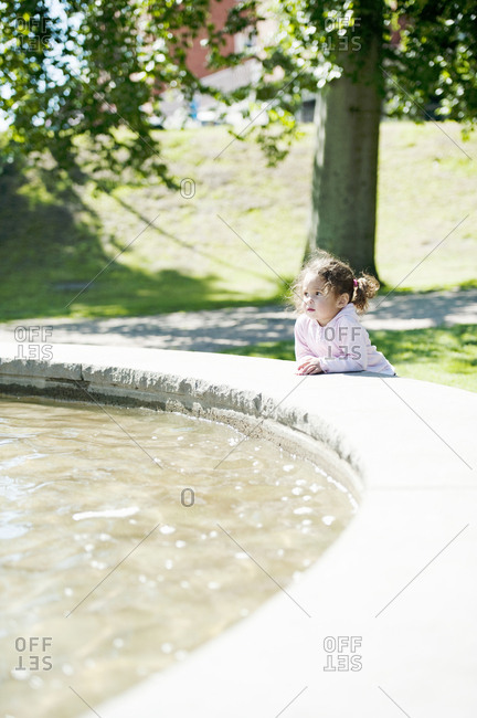 Girl by pond in park